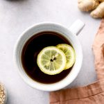 A mugful of digestion tea with ginger and lemon.
