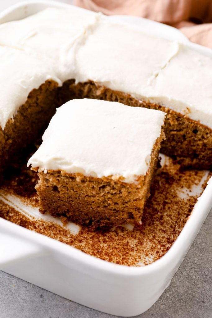 Frosted banana cake in a white baking dish.