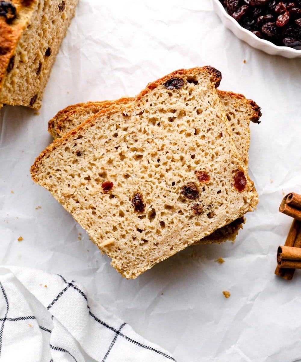A slice of gluten free bread with raisins and cinnamon.