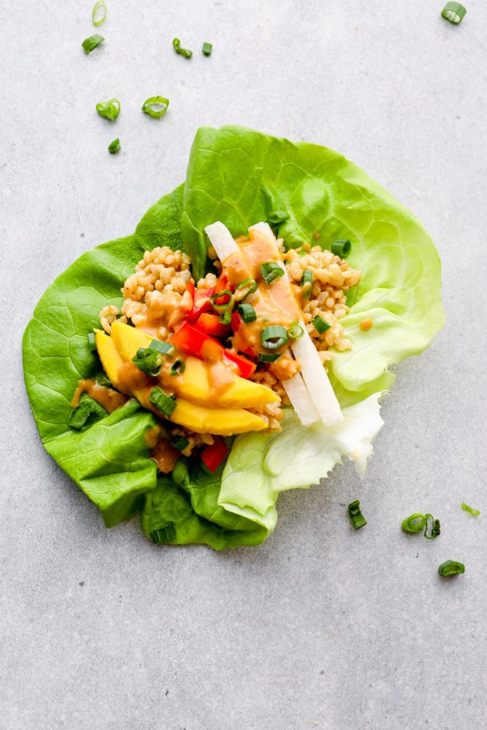 Lettuce cups filled with rice, jicama, mango, bell pepper and peanut sauce.