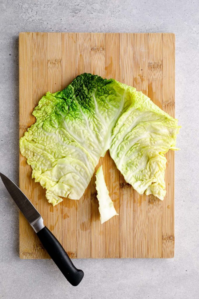 The stem cut out of a softened cabbage leaf.