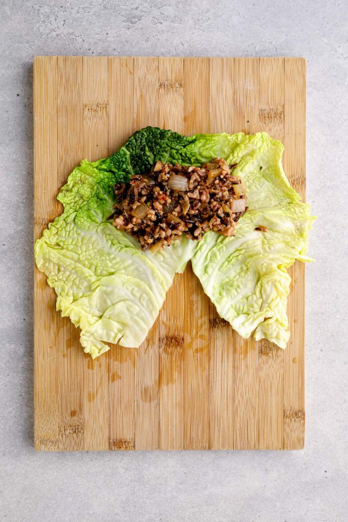 Wild rice and mushroom stuffing on a cabbage leaf.