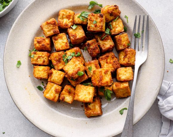 Air fried tofu on a plate with cilantro.