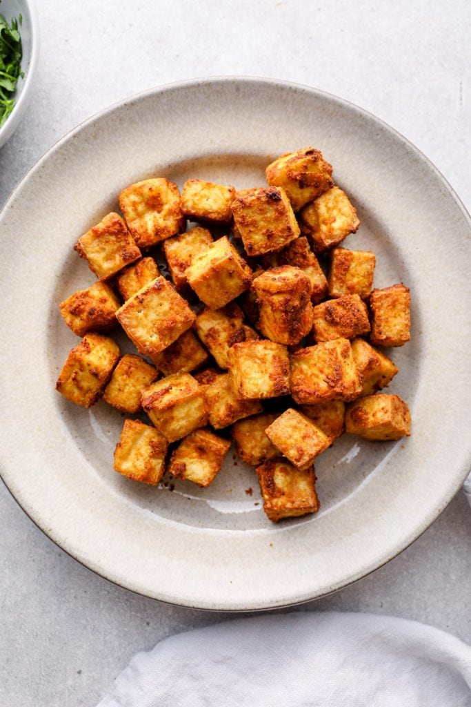 A plate filled with crispy tofu.