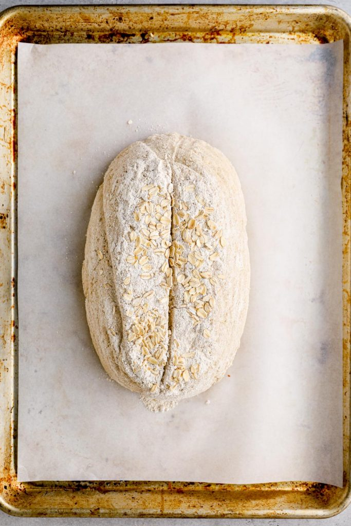 Unbaked bread on a sheet pan.