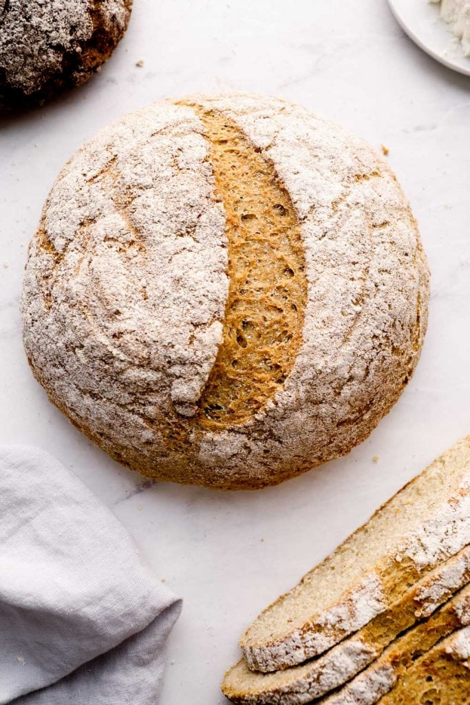 Artisan gluten free bread on a marble counter.