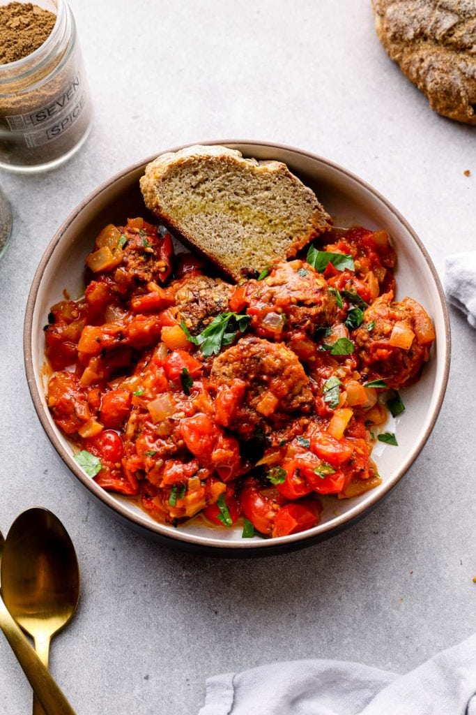 Lebanese lentil meatballs served with bread and parsley.