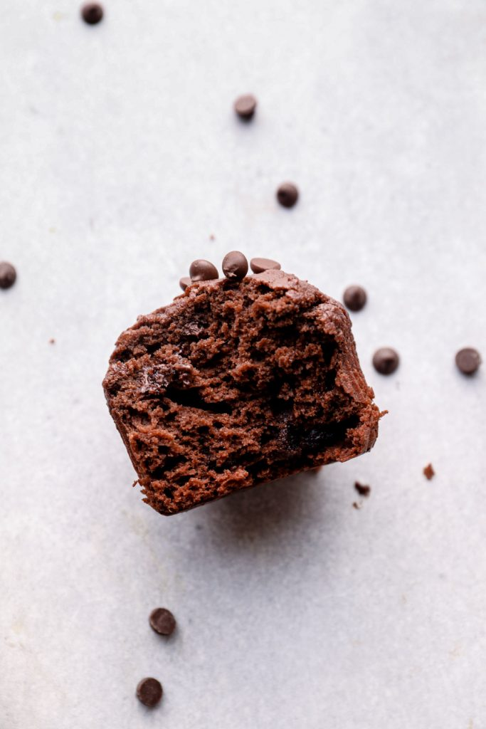 A bite out of a sweet potato chocolate muffin.
