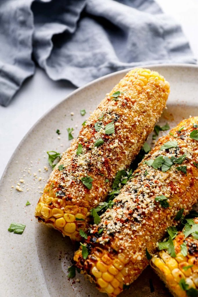 Vegan elote on a plate with cilantro.