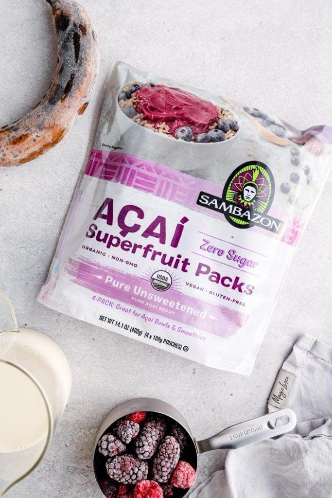 A frozen banana, almond milk, frozen berries, and acai puree packs.