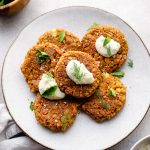 Chickpea patties served with herbs and yogurt.