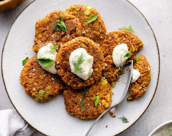 A plate of chickpea patties with herbs.
