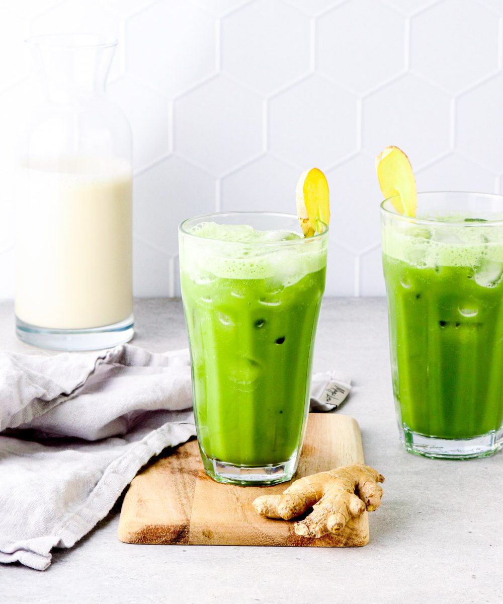 Two pineapple matcha drinks with coconut milk and ice.