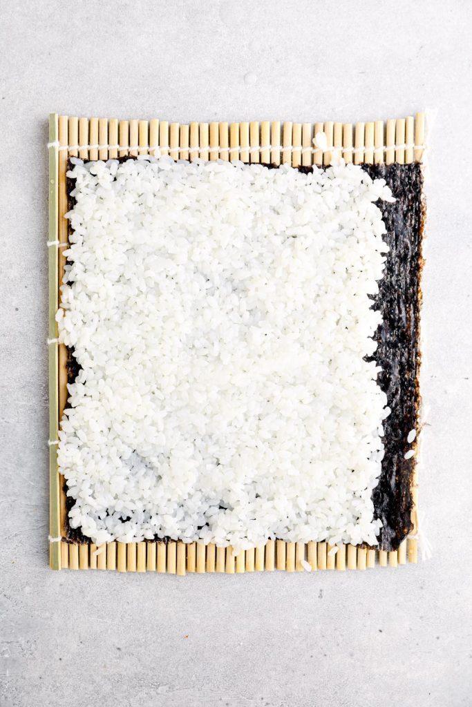 Sushi rice spread onto nori.