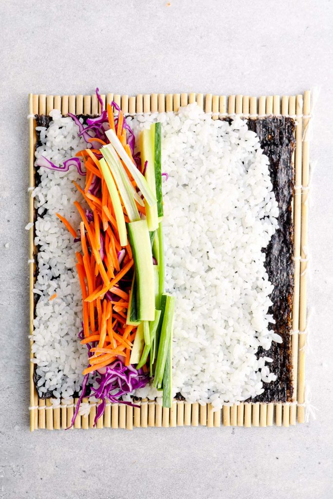 Unrolled sushi on a bamboo mat.