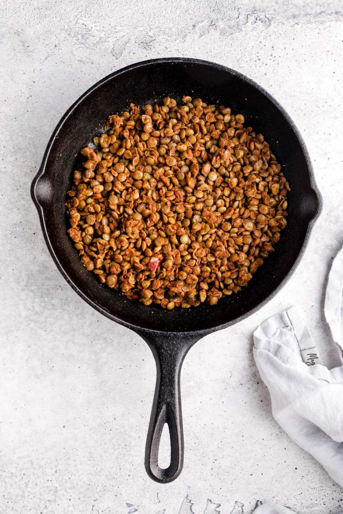 Lentil taco meat in a cast iron skillet.