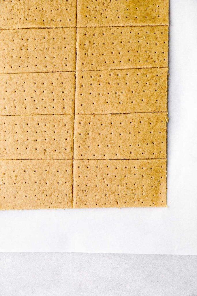 Sliced and scored graham cracker dough.