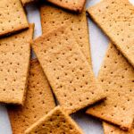 A pile of gluten free graham crackers.