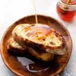 Spicy honey drizzled on toast.