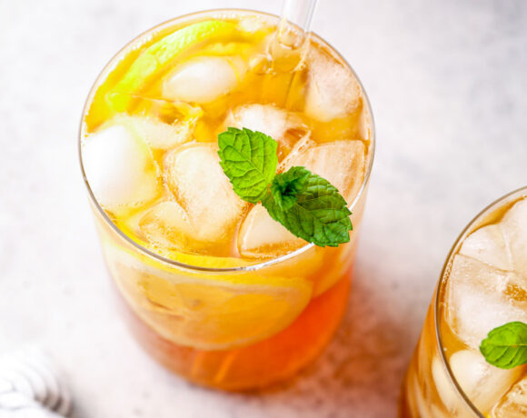 Lemon iced tea in a glass with mint.