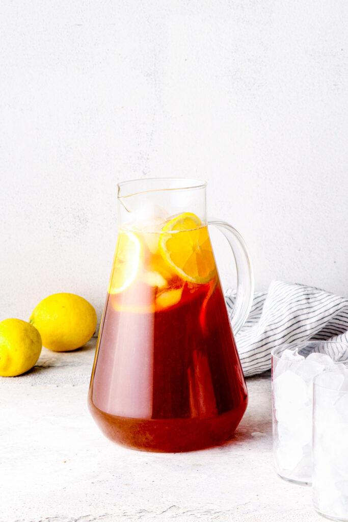 A pitcher of lemon iced tea.