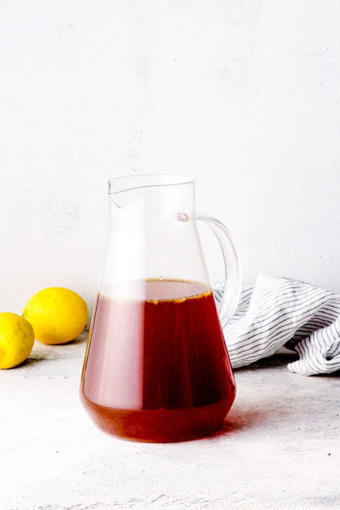 Black tea in a glass pitcher.