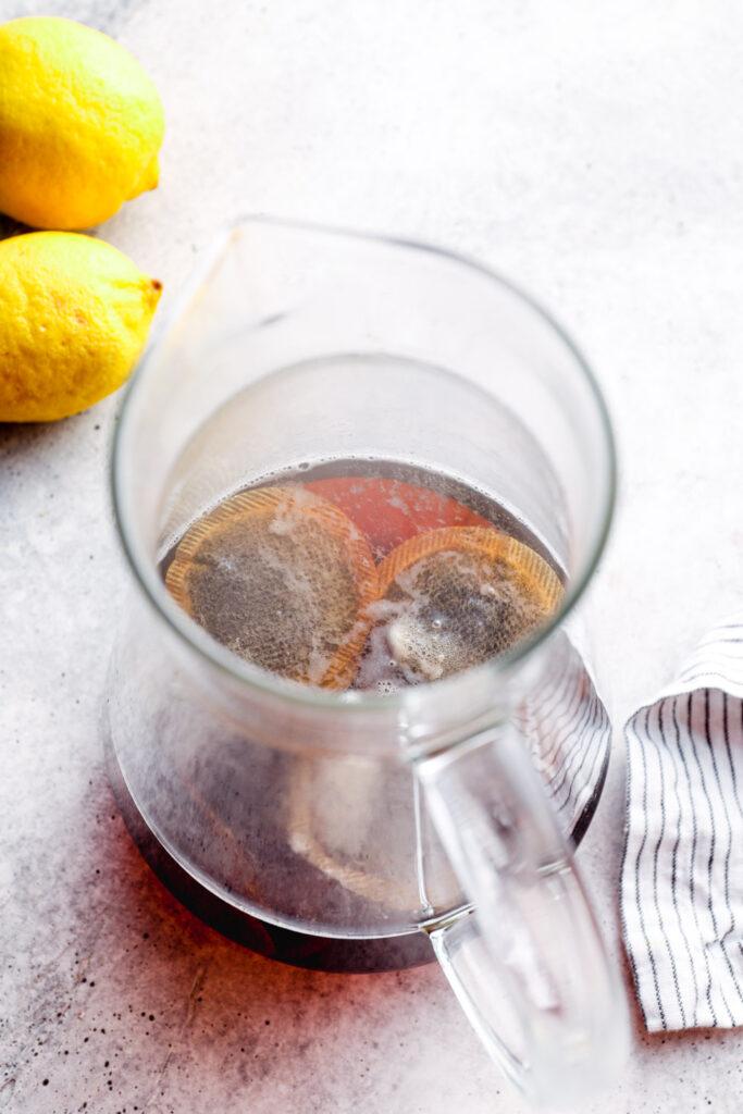 Black tea brewing in a pitcher.