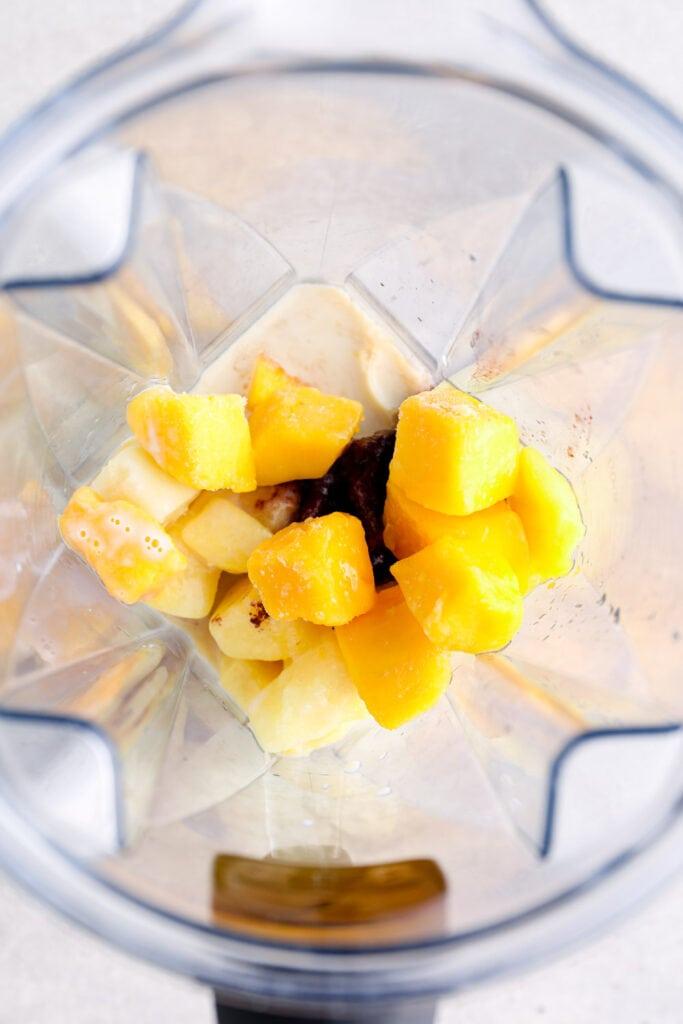 Acai, pineapple, bannana, and mango in the blender.