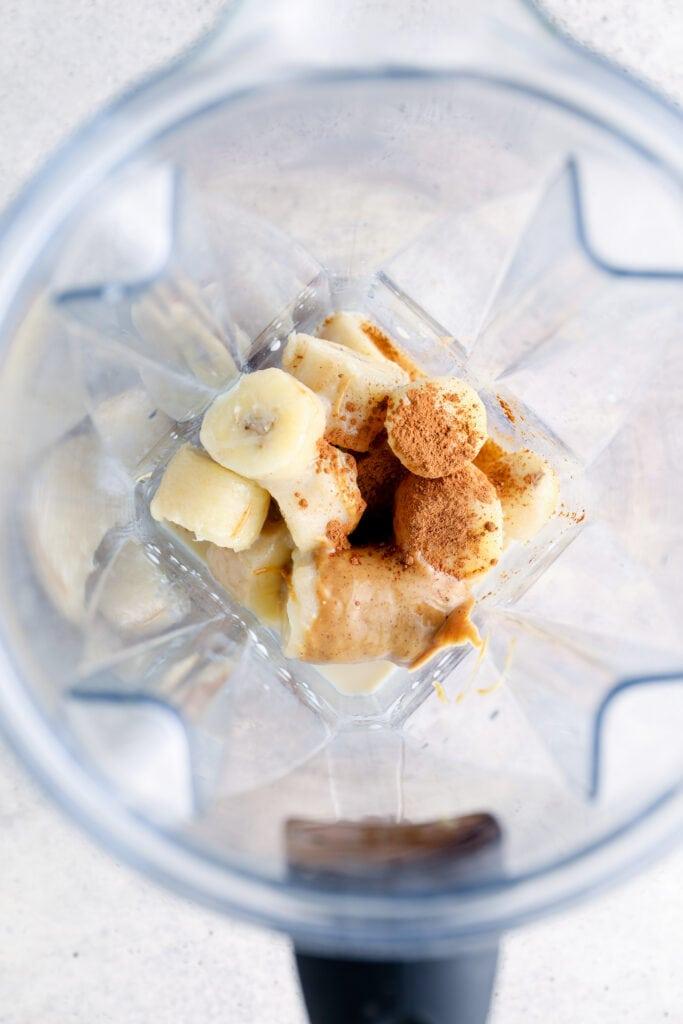 Banana, cinnamon, milk, and peanut butter in a vitamix blender.