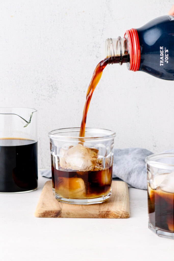 Cold brew being poured over ice.