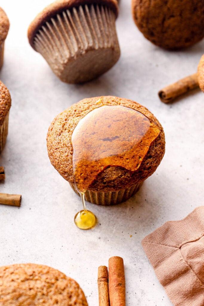 Honey dripping off of a gluten free pumpkin muffin.
