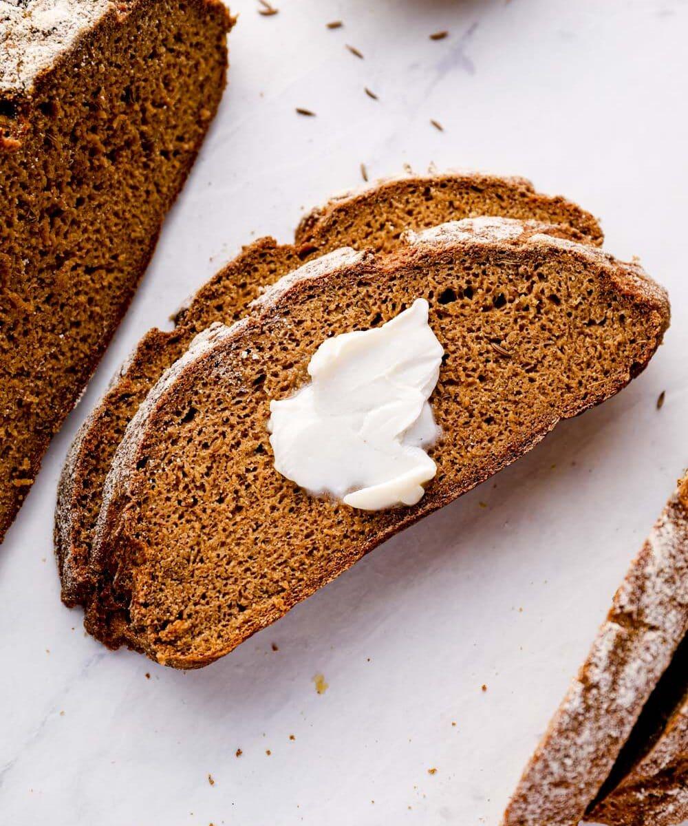 Gluten free rye bread with butter.