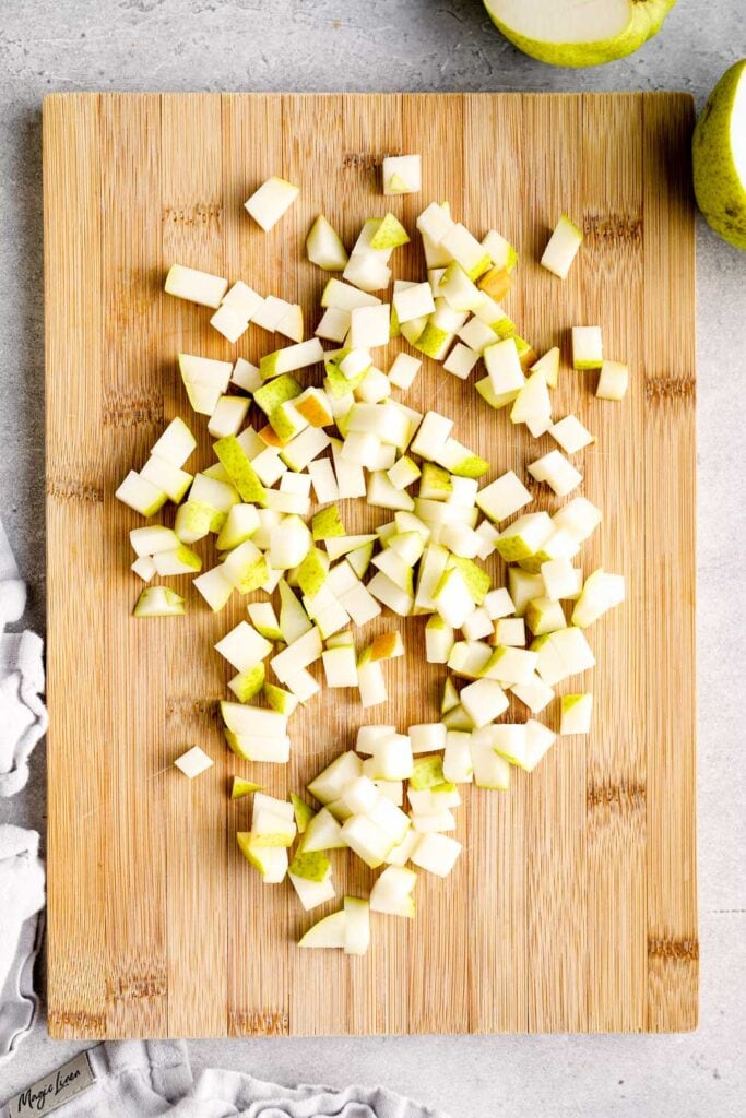 Diced pears on a cutting board.