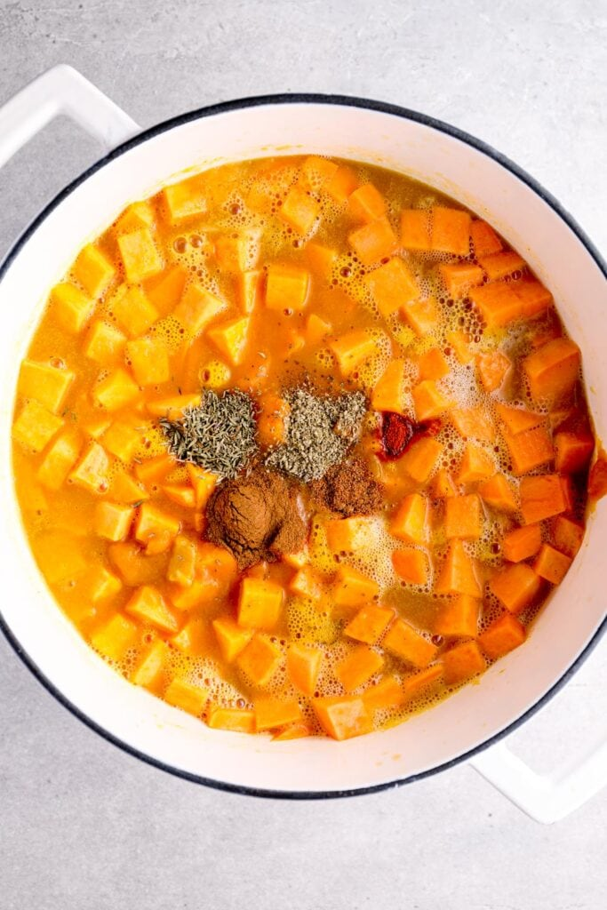 Sweet potato, broth, and spices added to the soup.