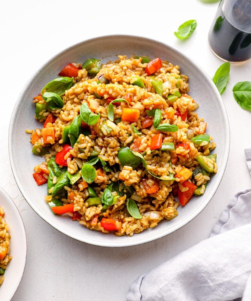 Thai basil fried rice served in a blue bowl.