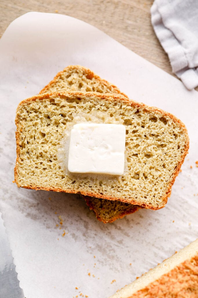 Butter on two slices of buckwheat bread.